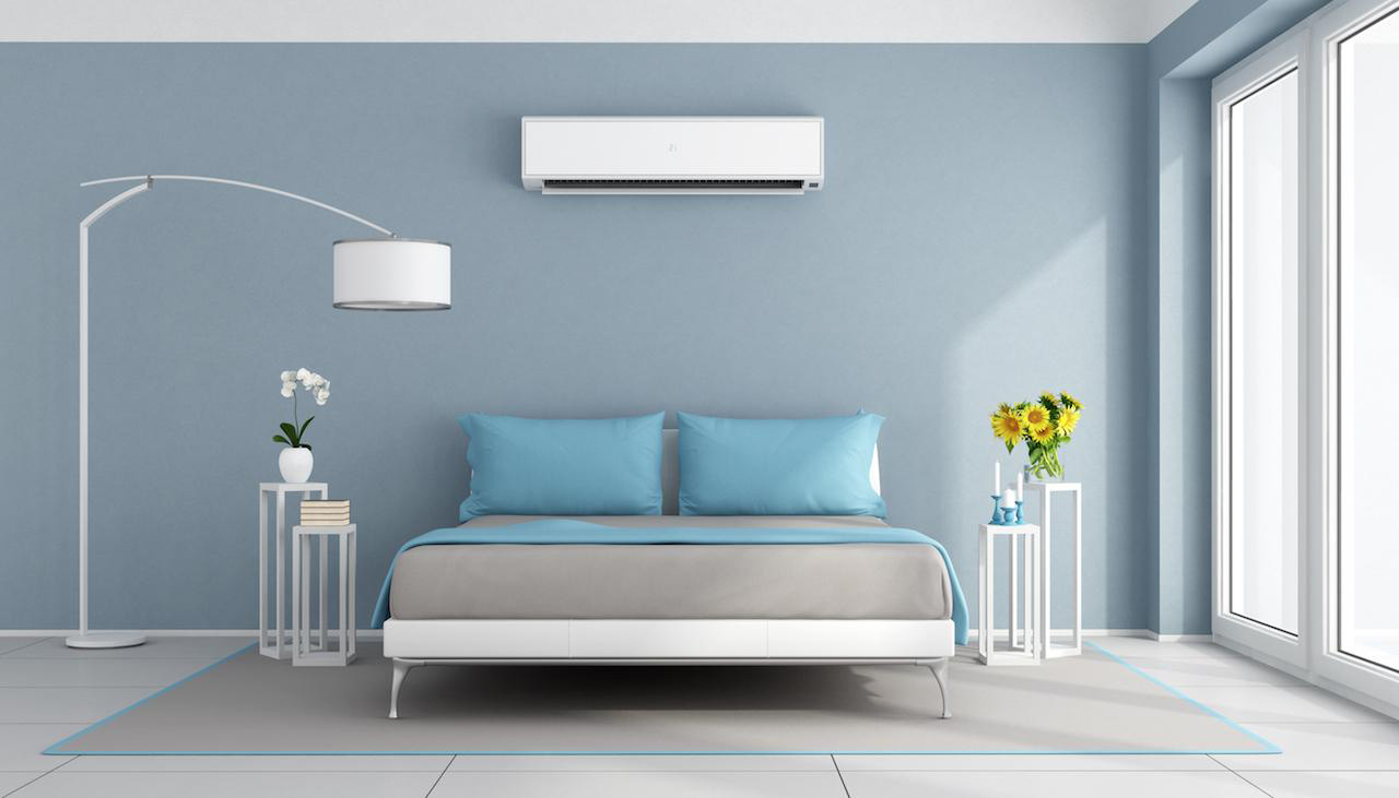 Wall mounted air conditioner in a bedroom