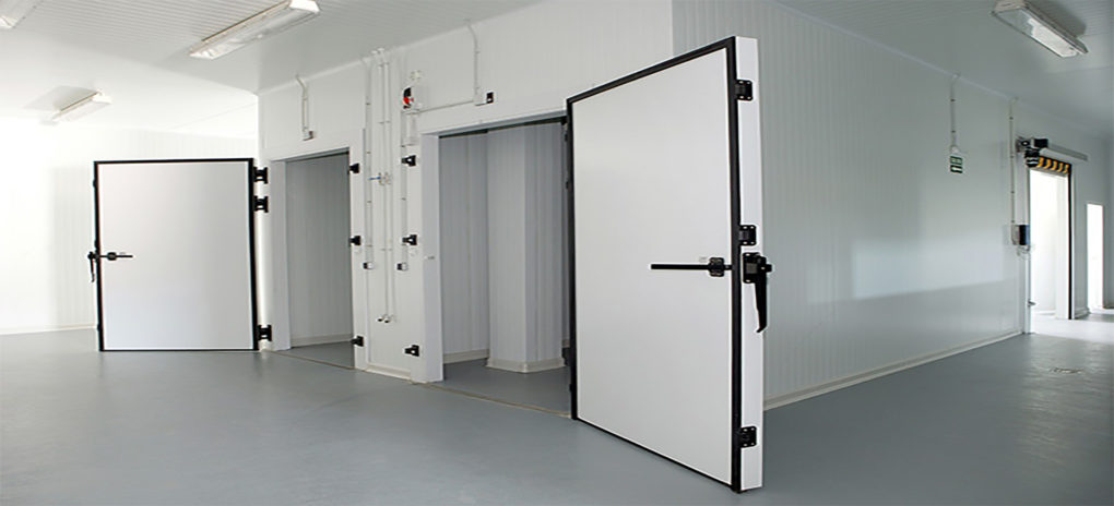 Two large refrigeration cold room doors opened wide