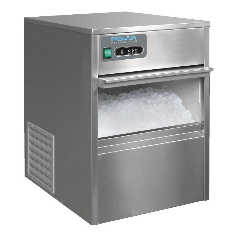 Ice machine with its door open showing a tray full of ice. Refrigeration supplied by Torr Engineering.