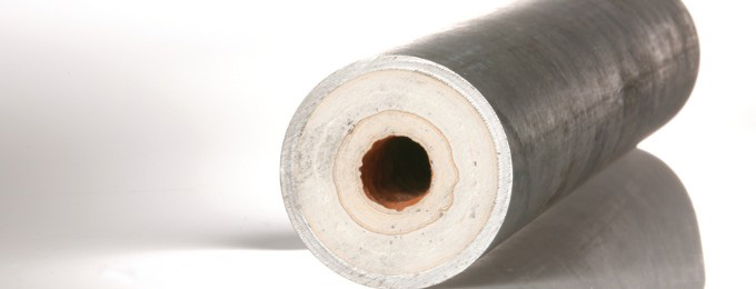 Limescale buildup inside a pipe reducing the pipe's internal diameter